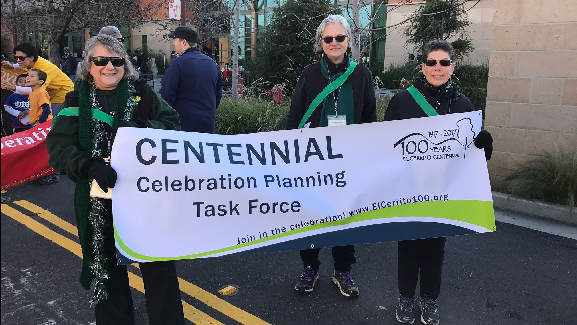 Members of the Centennial Celebration Planning Task Force carrying a banner